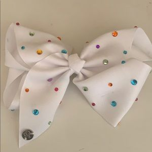 white jojo bow with rainbow rhinestones